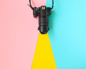 Fashion Film Camera. Hot Summer Vibes. Pop Art. camera. Hipster Trendy Accessories. Sunny summer Still life. Bright Sweet fashion Style. Surreal, Minimal Fun.Vanilla Pastel Color